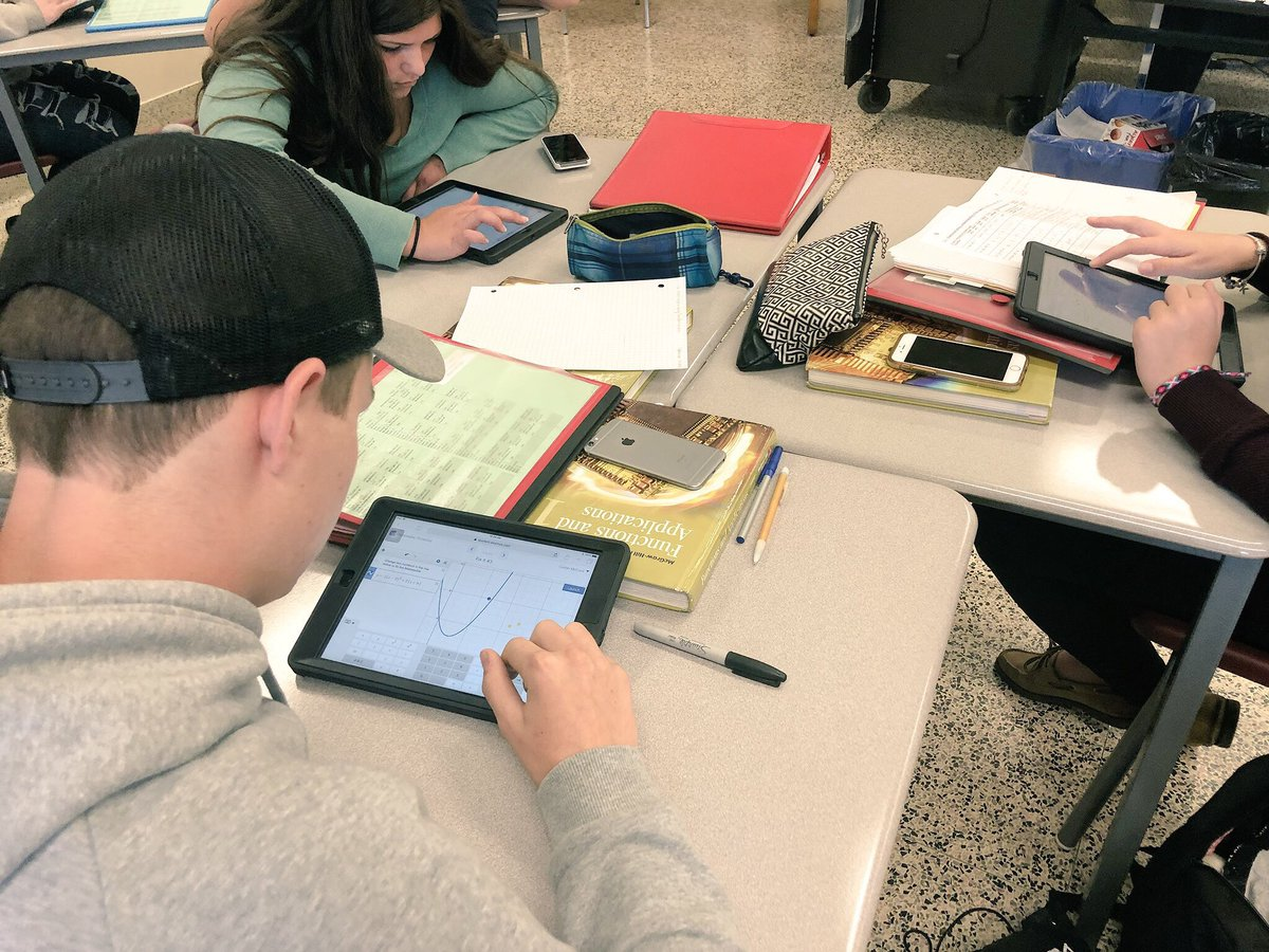 I don't have a phone ban in my classes: engaged students don't get distracted! Took this pic to show students using @Desmos marbleslide, and only noticed the untouched phones afterward. @ADHSMathDept #RCDSBMath #ITeachMath #MTBoS #MCF3M #QuadraticFunctions #BYOD