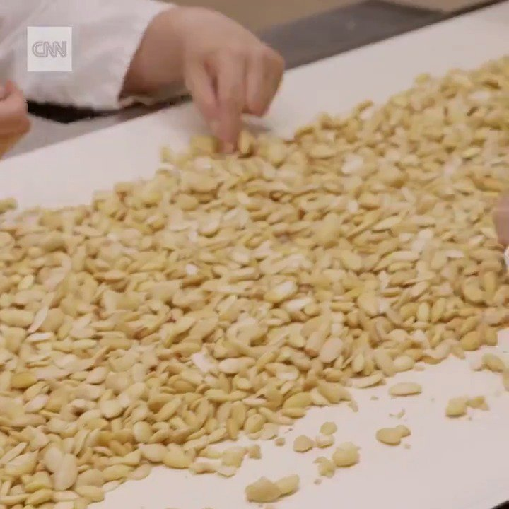 This is how roasted almonds are turned into marzipan. cnnmon.ie/2MOzF4j