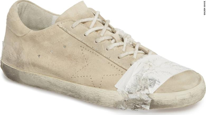 These grungy, taped-up designer sneakers sell for $530. Critics say they glorify poverty cnn.it/2DgT4v9