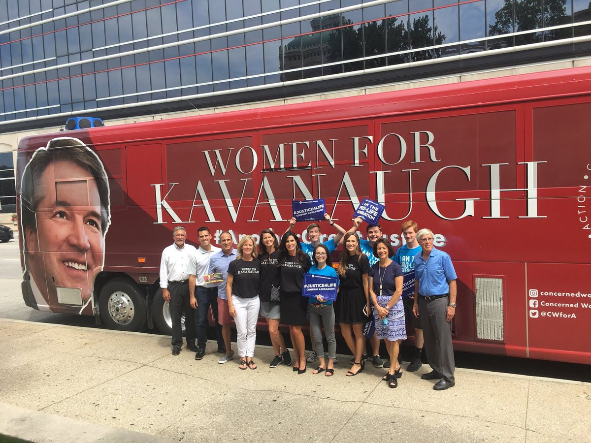 There are 6 women in this photo. Where are the other 59? Are they posing on the other side of the bus?