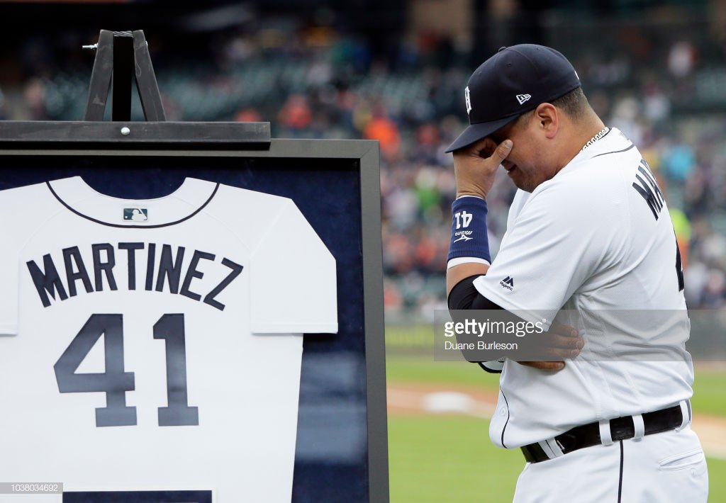 669e7aa9fa Victor Martinez of the Detroit Tigers becomes emotional near a framed  jersey to honor the last