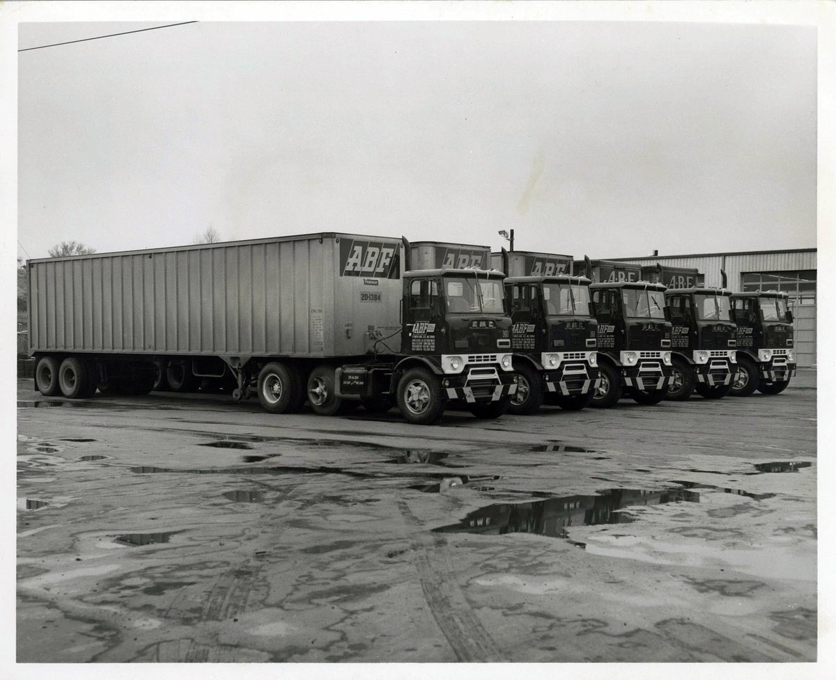 "ABF Freight's tweet - ""Throwback Thursday: ABF Freight trucks are lined up in this undated photo. Can anyone guess the year?"