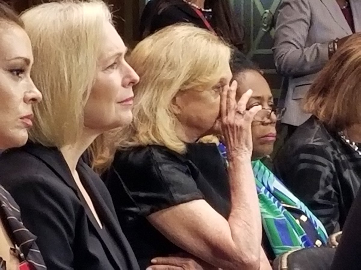 In the audience, tears streaming down the face of Rep Carolyn Maloney D-NY as she listens to Ford