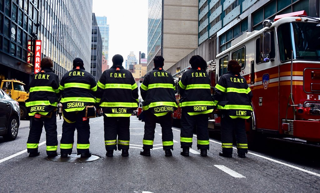 A color image of the 6 women of the first all-female firefighting crew in New York, from behind.