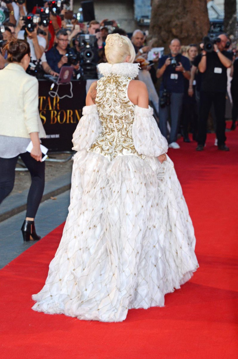See  wearing a  organza #McQueenArchivejacquard lace dress with three-dimensional gold and pearl embroidery from the Autumn/Winter 2013 collection to the London premiere of .   #AStarIsBorn #SeenInMcQueen #AlexanderMcQueen