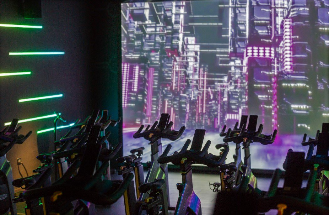 Image for Debenhams Sutton is now home to a double UK first – their first in-store SWEAT! gym & the UK's first flatscreen Les Mills IMMERSIVE FITNESS™ studio using a single projector. This space-saving solution and our AV help this little studio pack a big imme