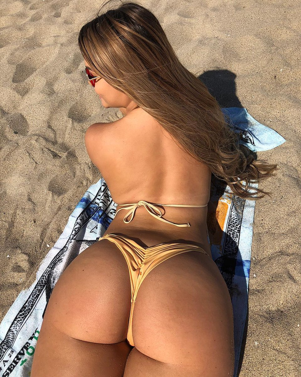 Round ass babe stretching in thong