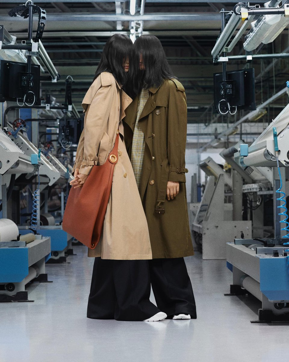 Xu wears The Westminster in honey. Ling wears The Westminster in dark military khaki. The new Heritage Trench - refined into five new colours and three contemporary fits. Made in Castleford. #BurberryTrench brby.co/79e