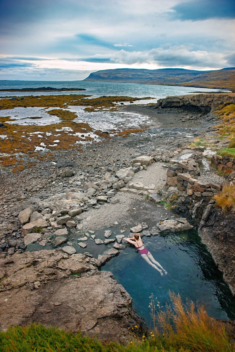 A hidden hot spring in #Iceland with an ocean view is the most relaxing way to end a day exploring!! #TravelTheWorld