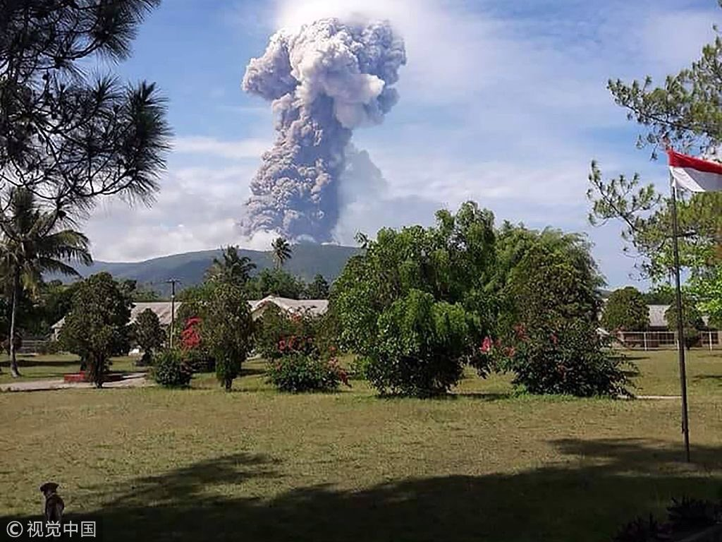 A volcano erupts in Indonesia on the same island as earlier earthquake.