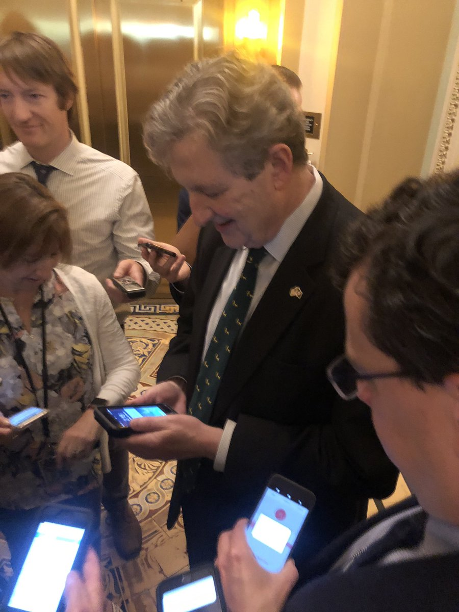 "3cabcb0947 Sen Kennedy gets the presidential alert in his phone while talking to  reporters  ""Oh"