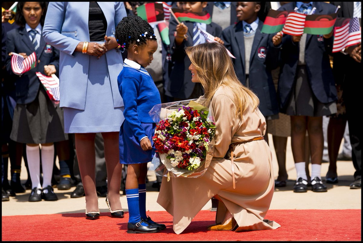 .@FLOTUS talks with a little flower girl during a welcoming ceremony as she arrived in Malawi. #FLOTUSinAfrica2018