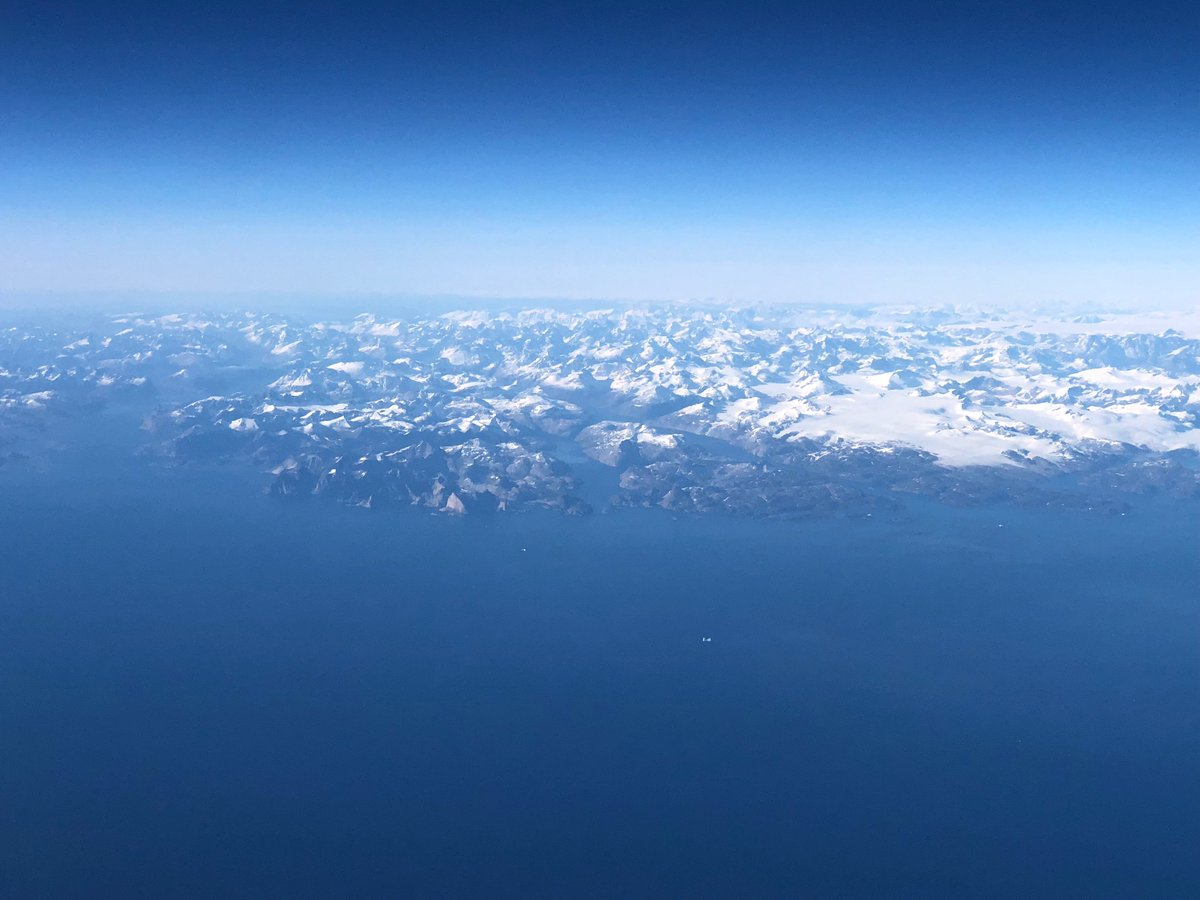 Beautiful over the Southern tip of Greenland. And now evening in New York.
