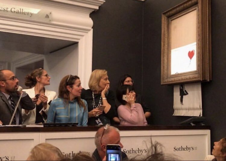 Banksy's painting self-destroyed and shredded itself right after it sold for $1.3mill by Sotheby's in London