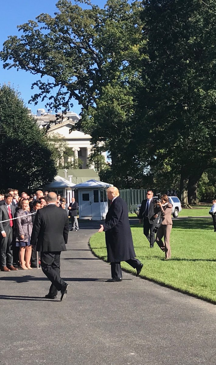 The topcoat is back! On a sun-splashed fall day in Washington, with a temperature of 57, the president dons his favorite black wool coat as he heads West for three day campaign swing.