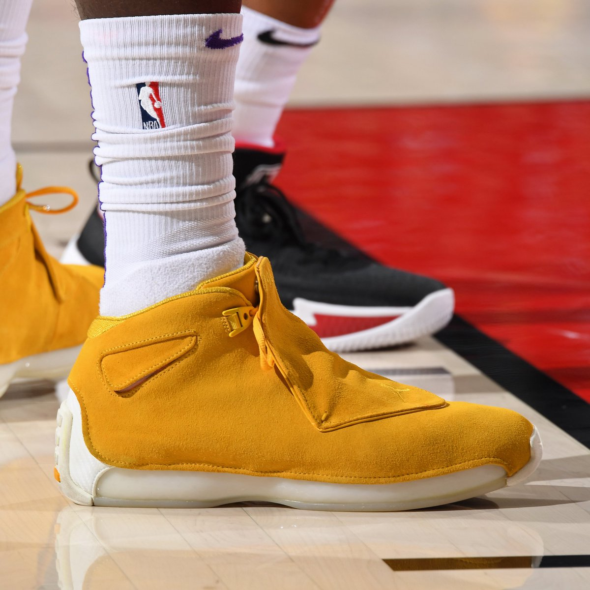 "#SoleWatch: @stephensonlance makes his Lakers debut in the ""Yellow Ochre"" Air Jordan 18. 📸: @ADBPhotoInc"