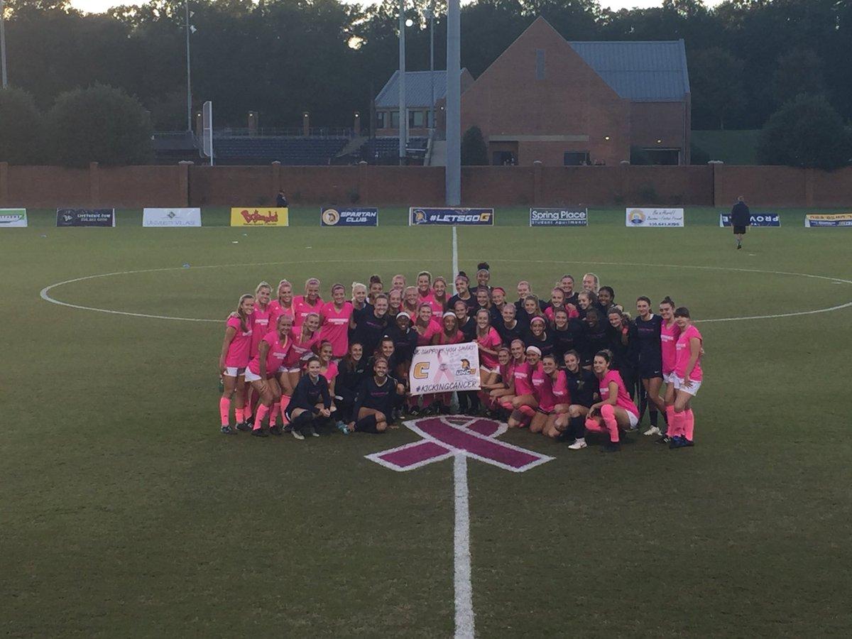 29b3714ec3b ... wearing pink to offer support for opposing head coach Gavin McKinney s  wife Shari