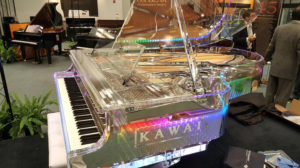 Theres nothing like it anywhere - the KAWAI Crystal Grand Piano - vivid neon colors for the KAWAI Friday Night Lights #FridayNightLights #KAWAI #piano #pianist #musicians #FridayFeeIing