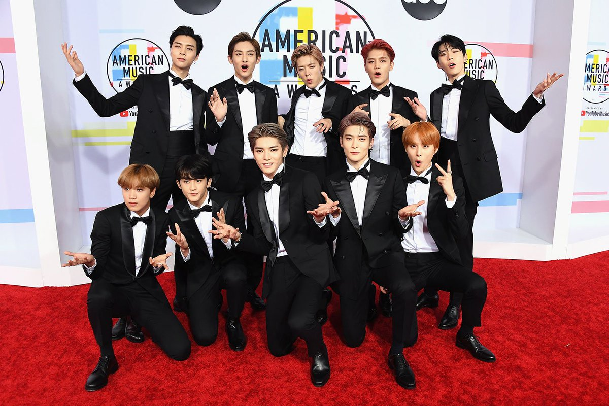 Wow, #NCT127 is definitely having more fun than anyone else posing at the #AMAs, and I love it.