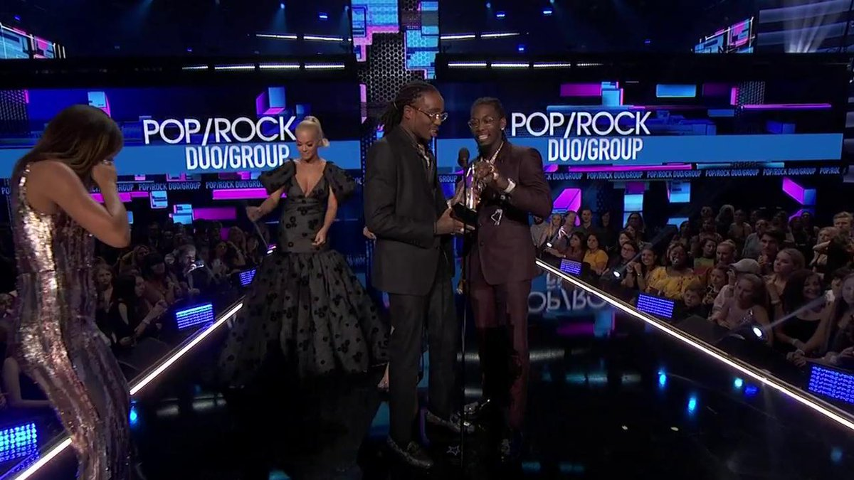 .@Migos accepts the award for Favorite Duo or Group - Pop/Rock, marking their first #AMAs win! 🎉
