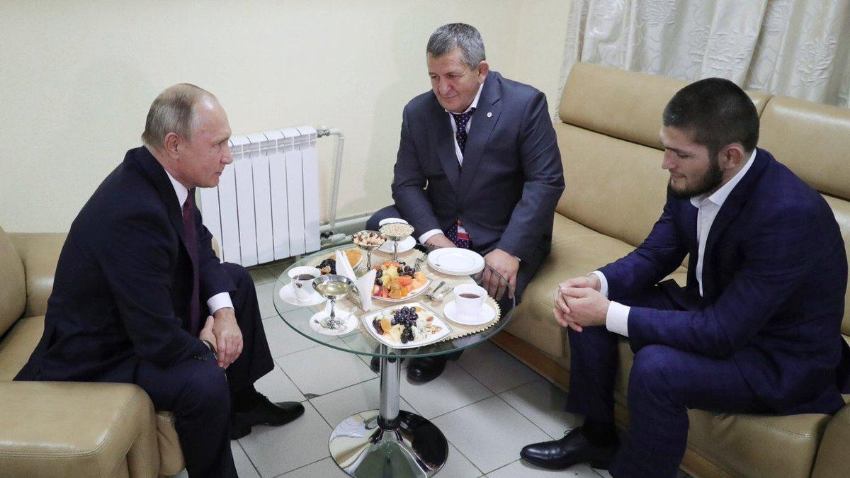 UFC's lightweight champion Khabib Nurmagomedov and his father in a meeting with Vladimir Putin