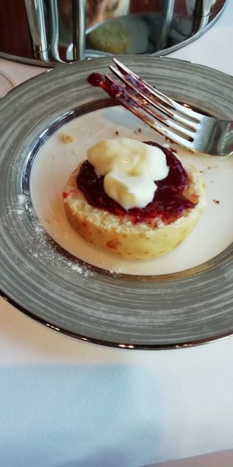 Happy birthday with jam on and cream on top of course