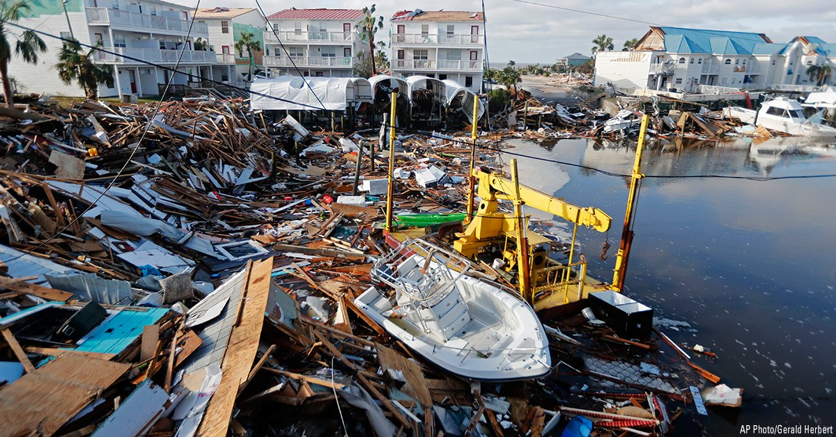 A boat sits amidst debris in the aftermath of Hurricane Michael in Mexico Beach, Florida.