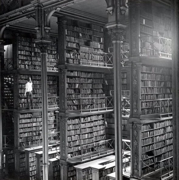 A man browsing for books in Cincinnati's cavernous old main library, 1942