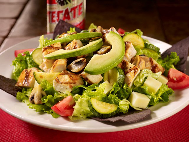 with sizzling chicken zucchini added right at the table to salad greens mixed with avocado jack cheese tomatoes blue tortilla strips our sizzling - Happy Garden Chico