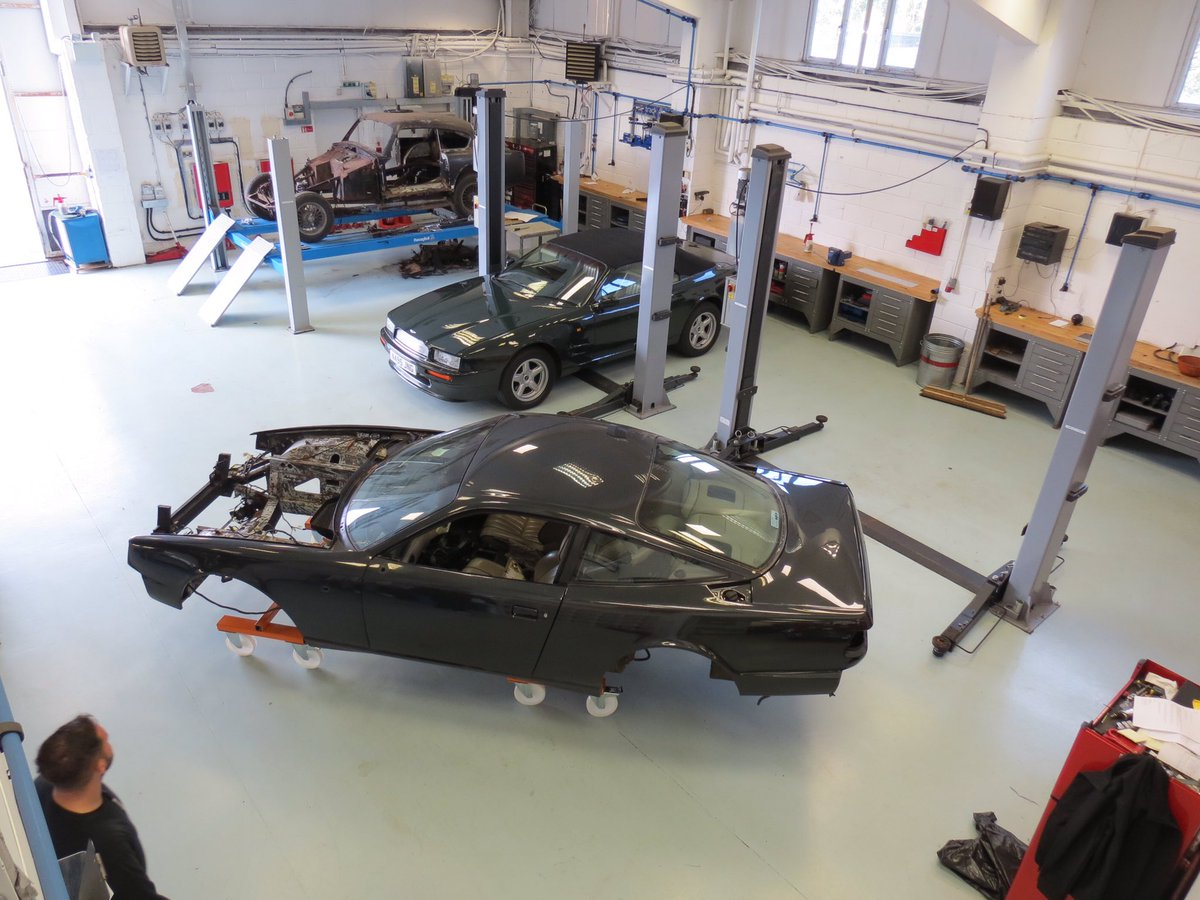 Great progress this week! Body now on trolleys and moved onto the next stage. Engine starting to take shape too. #AstonMartin #virage #RowanAtkinson <br>http://pic.twitter.com/i3o2ZUzpOu