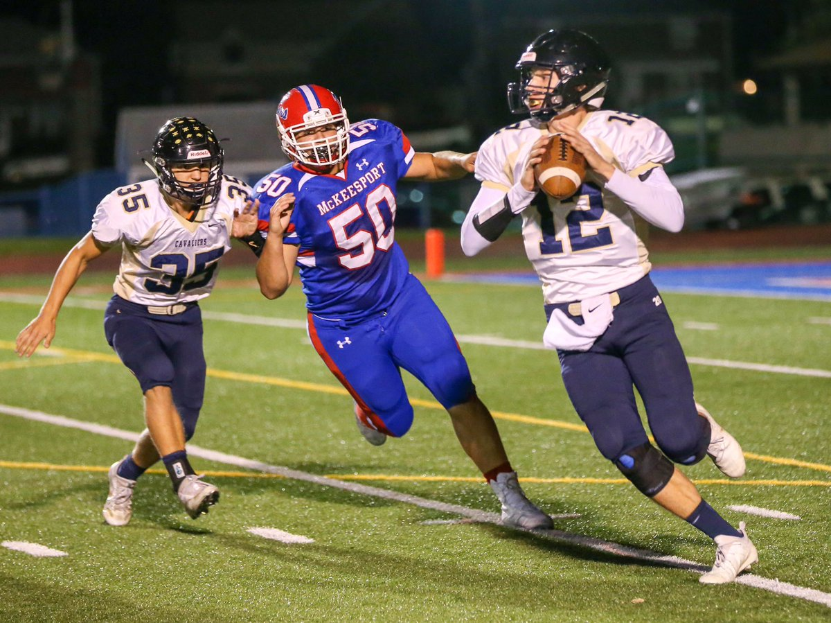 Kiski Area QB Ryne Wallace looks for an open receiver while McKeesport's Dylan Vaniel chases him down <br>http://pic.twitter.com/lfD7MO4DFd