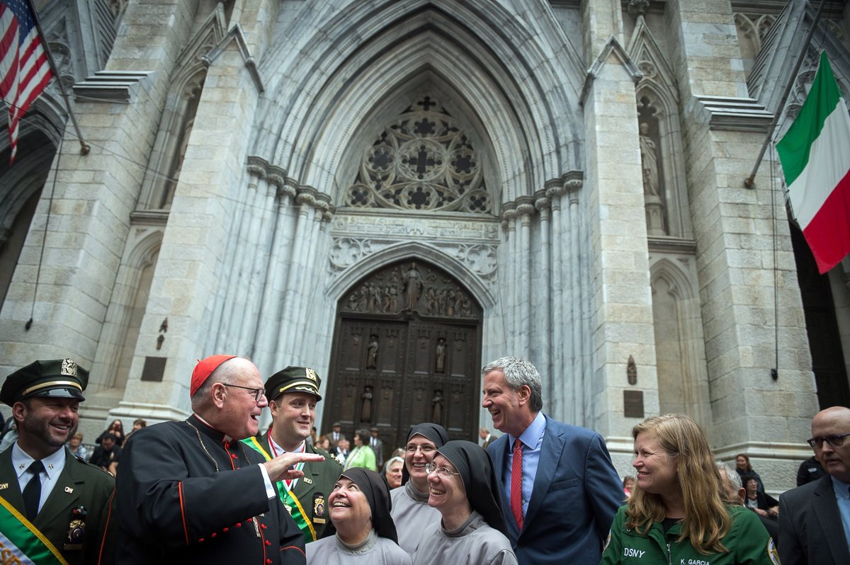 @CardinalDolan greeted @NYCMayor outside @StPatsNYC during the Columbus Day Parade on Fifth Avenue on Monday.