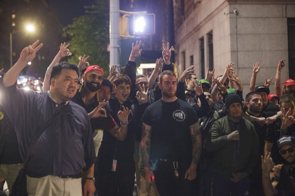 Here's the people you're defending, the Proud Boys flashing their white power hand signals. @huntedhorse has the REAL story &amp; pix. Jason Kessler, who killed Heather Heyer, was a Proud Boy. <br>http://pic.twitter.com/r32ZImGyHr