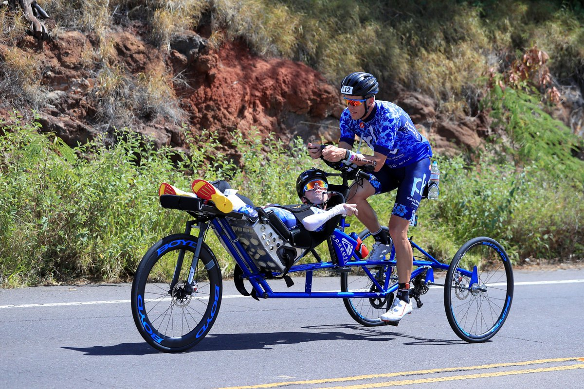8866fce21de10 Together. Brothers Brent and Kyle Pease are beyond the 70 mile mark on the  bike