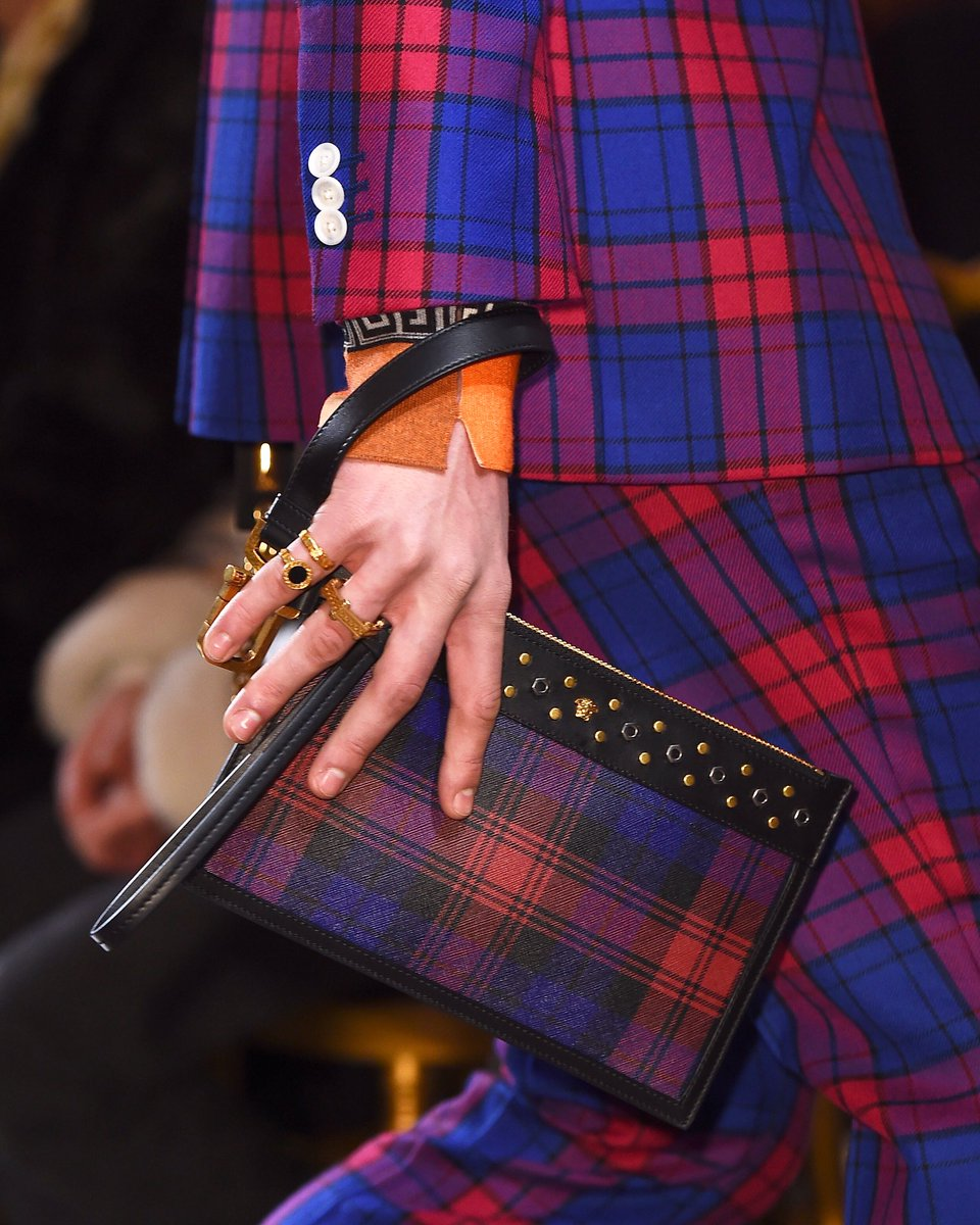 Grasp onto the season's tartan accessories.   Find the #VersaceFW18 men's collection: https://t.co/NoSI7cBtKP