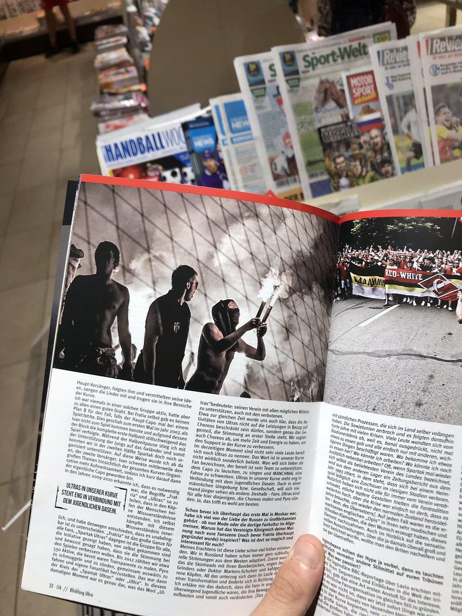 в немецком газетном магазине нашим толстый журнал про футбольных ультрас, а в нем — мой украденный кадр
