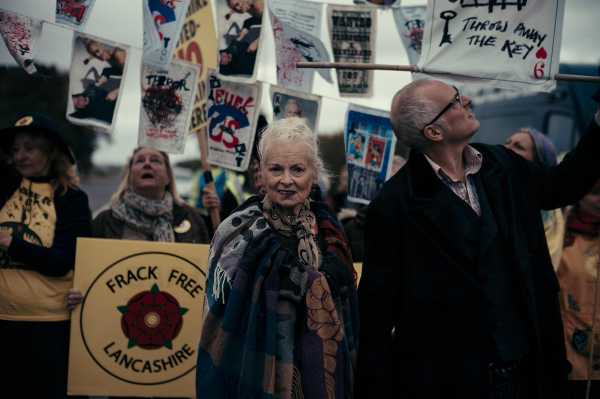 """Earlier today @FollowWestwood headed to Preston as part of her ongoing fight against Conservative Party-sanctioned fracking in Lancashire. The designer protested alongside her son, and took a jab at Theresa May by dancing to ABBA's """"Dancing Queen"""".  📸 Robert Binder"""