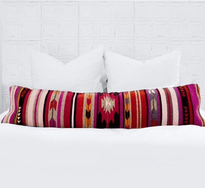 Throw pillows aren't your only option for a pop of color on white linens! Opt for a stylish lumbar pillow instead. https://goo.gl/919vPl