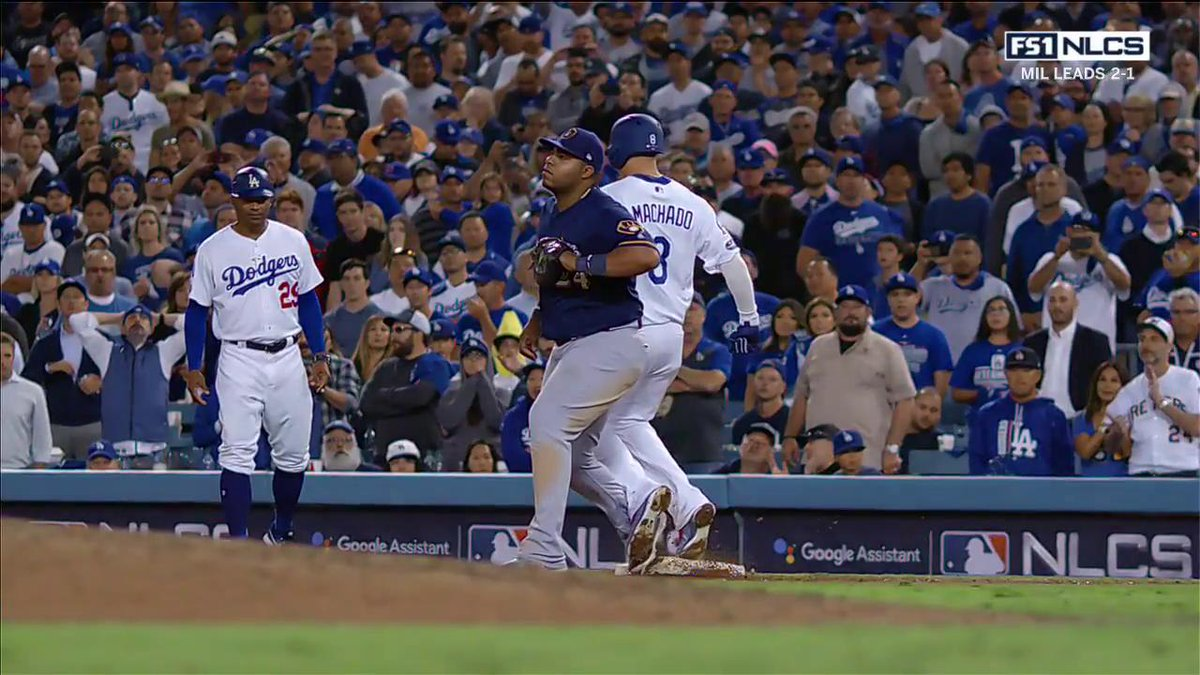 Benches clear for a moment in #NLCS Game 4 after an incident at 1st base between Manny Machado and Jesus Aguilar.