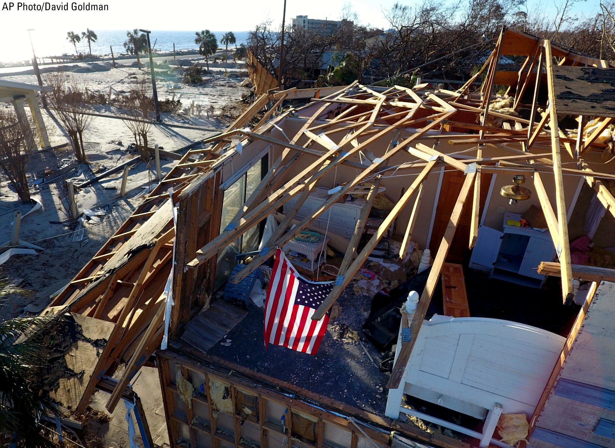An American flag hangs in a bedroom of a damaged home from Hurricane Michael in Mexico Beach, Florida. https://t.co/XpKoqznGF8