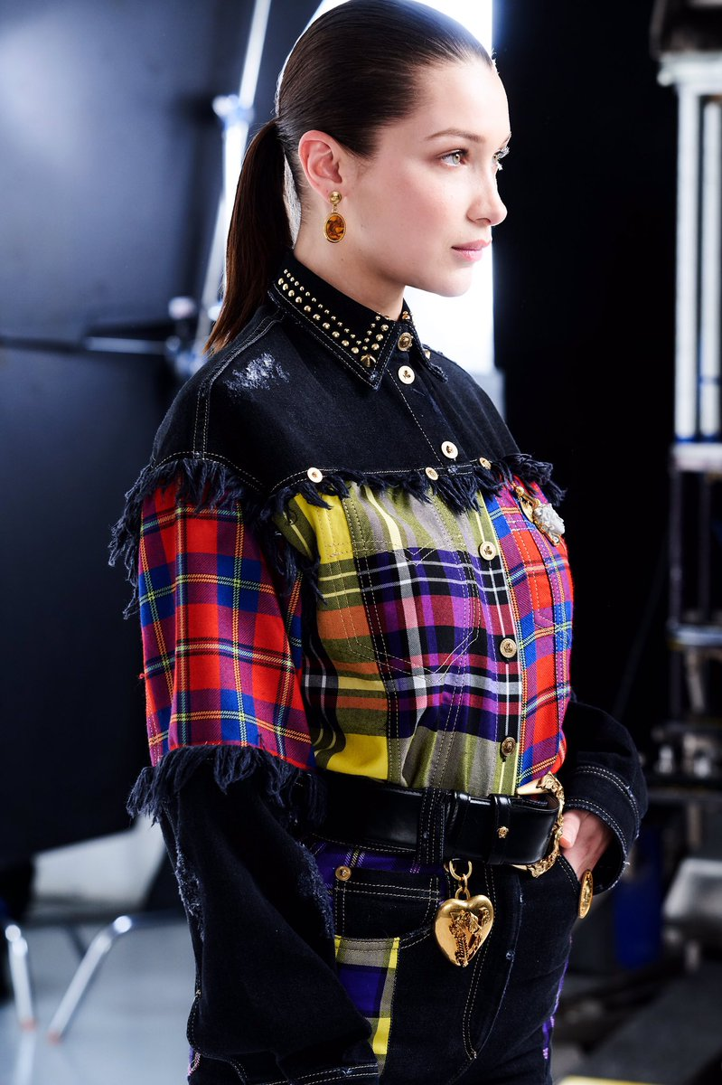 The statement piece: fringed denim shirt with wool Tartan inserts from the #VersaceFW18 collection.   Shop now: https://t.co/KyWfGY3SYW