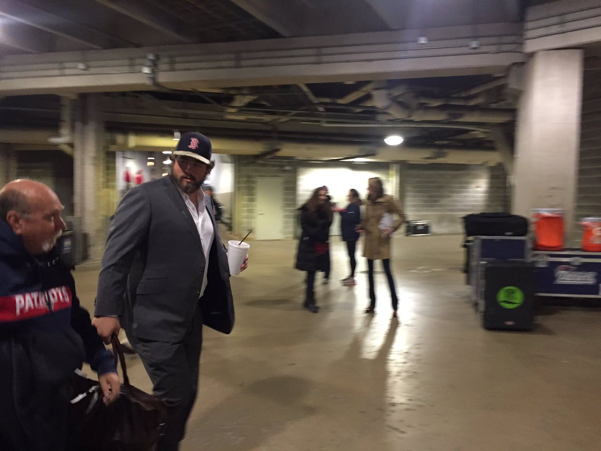 Starting center David Andrews, who grew up a Braves fan, dons a Red Sox cap upon arrival at Soldier Field.