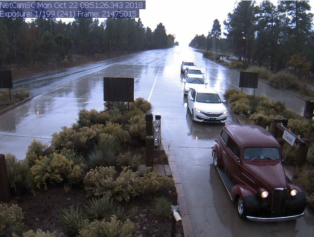 Wet roads on SR 64 at Grand Canyon entrance station to South Rim. #azwx #aztraffic