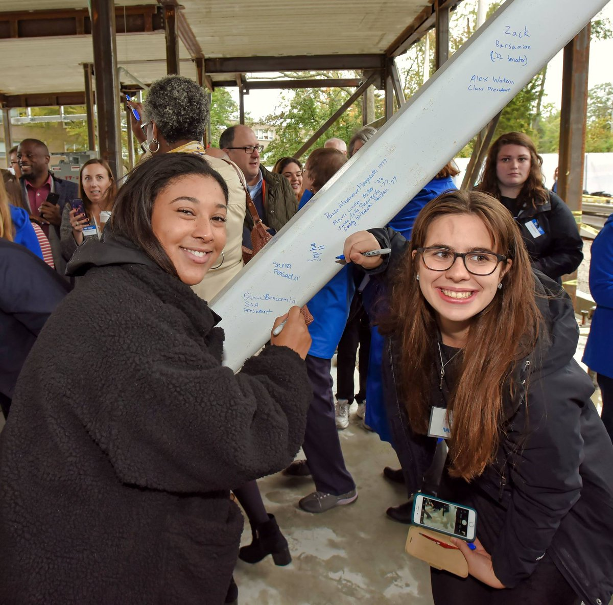 Students, alumni, parents, and other members of the Wheaton community had the chance to sign their names on beams inside Wheaton's new residence hall, currently under construction.  @SGAarch https://t.co/uQKZzyZuQt