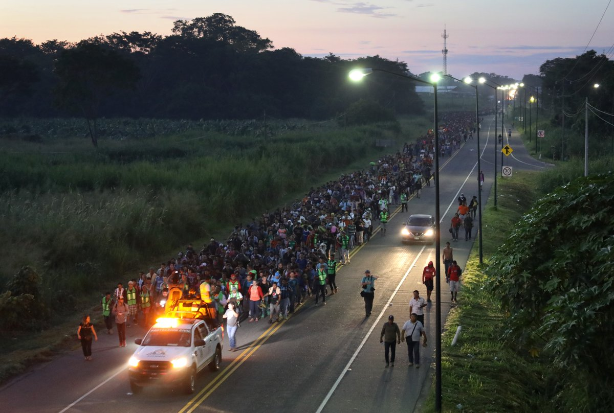 PHOTOS: The massive train of migrants traveling to the USA is being ESCORTED through Mexico by security vehicles.  Photos show police just standing & watching them. Lit security vehicles guiding them.  Who is paying for this?!  Biggest story in the world right now  Pay attention.