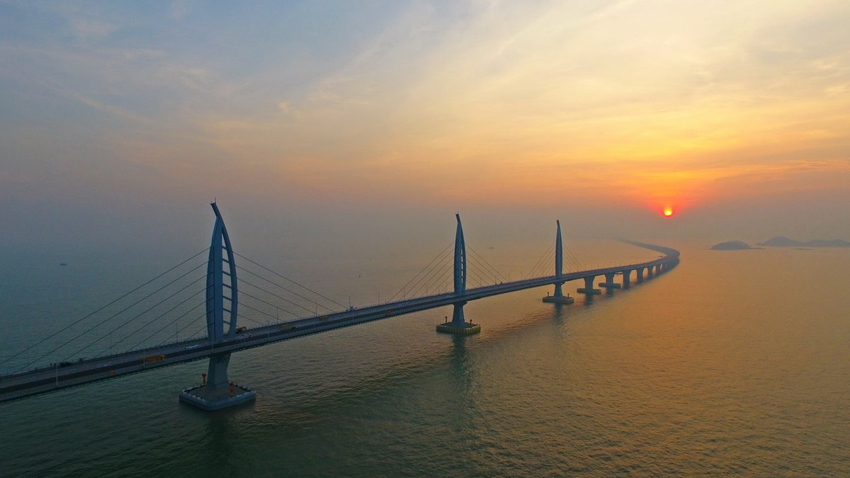 Xi Jinping announces the opening of the Hong Kong-Zhuhai-Macao Bridge at an opening ceremony in the city of Zhuhai, Guangdong Province