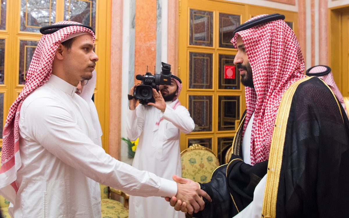IMAGE: Jamal Khashoggi's son shakes hands with Saudi Arabia's crown prince  (Via Saudi Press Agency)