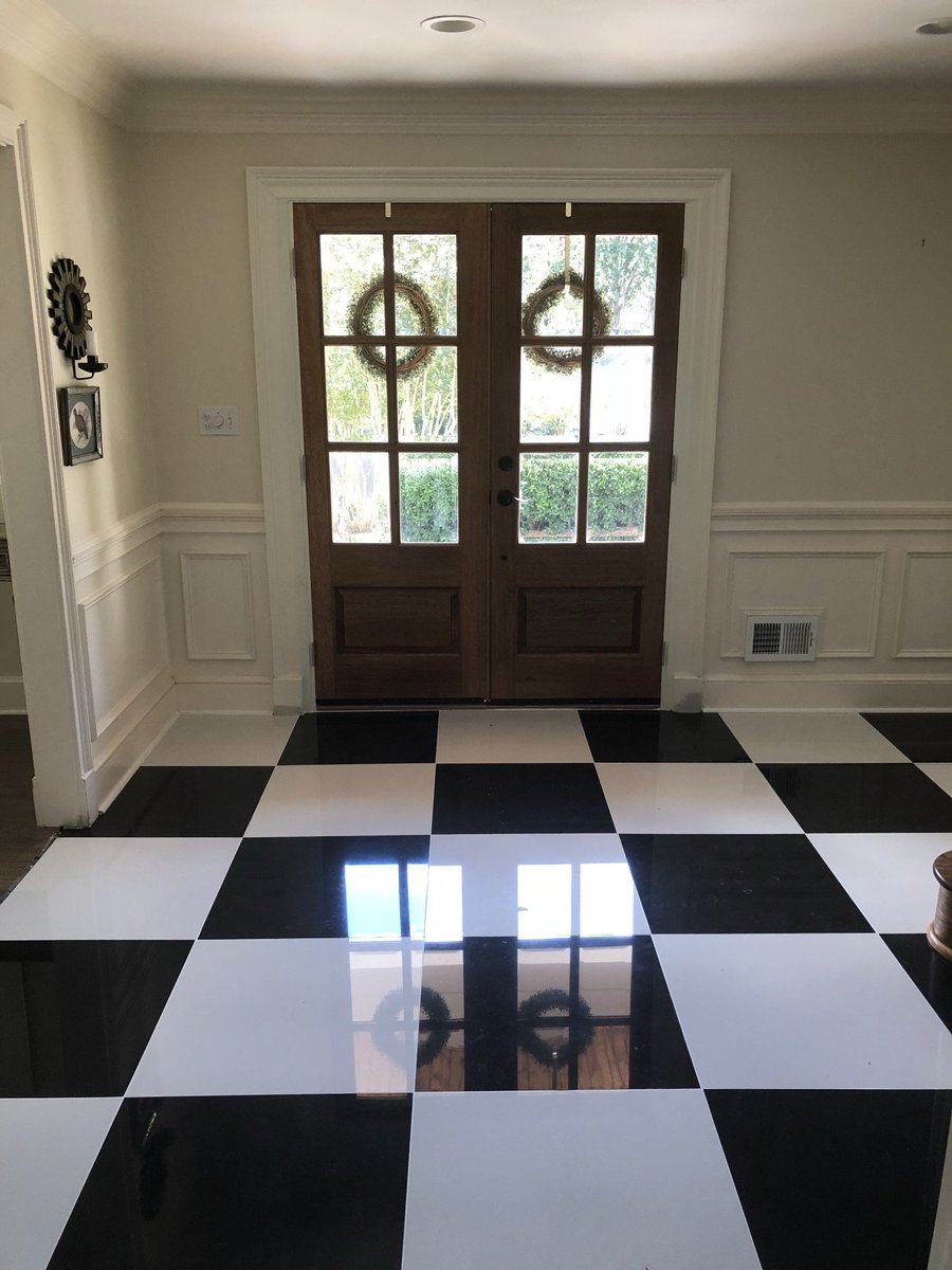 What an incredible entry! The black and white tile floors make for a stunning focal point. #TeamGREEN  #GBR #GreenBasementsAndRemodeling #RoswellRemodel #AtlantaConstruction #BlackandWhiteTile #foyerRemodel #Entry