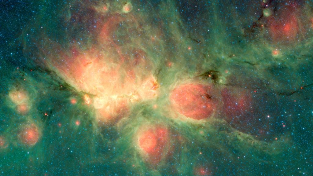 Space bubbles! Our @NASAspitzer Space Telescope captured this image of burning, bubbling star formation in the Cat's Paw Nebula. As gas & dust compress to form stars, the gas around these areas heats up & pressurizes—giving the appearance of bubbles. More: https://t.co/hq4OmAUrDK
