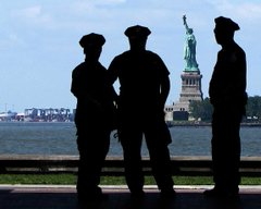 cops watching statue of liberty